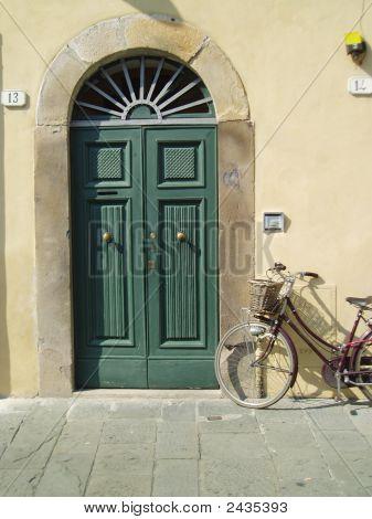 Green Door With Bicycle
