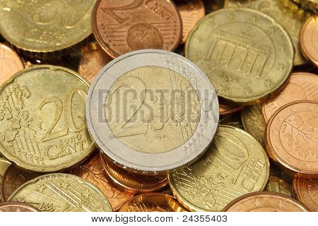 Two Euro Coin On Top Of A Pile Of Other Euro Coins