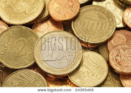 One Euro Coin On Top Of A Pile Of Other Euro Coins