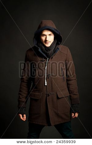 Man Wearing A Hooded Coat
