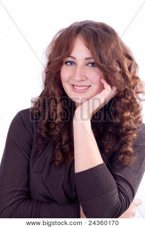Portrait Of Smiling Woman Resting Her Chin On Hand