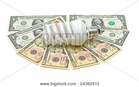 Energy Saving Light Bulb And Banknotes On A White Background