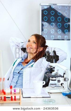 Doctor Woman Sitting At Office Table And Relaxing