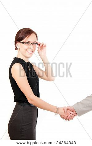 smiling business woman shaking male hand isolated on white