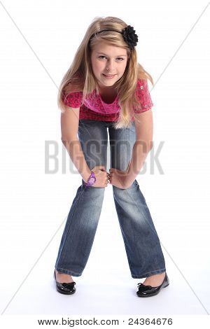 Cute Young Blonde School Girl Jeans And Pink Shirt