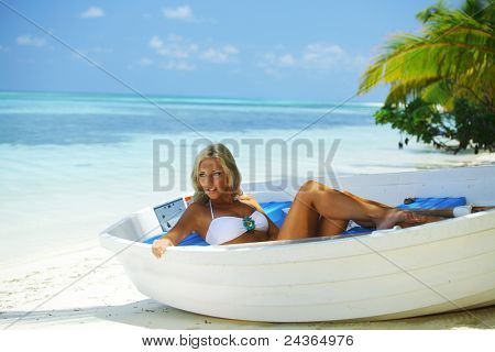 woman in boat under palm