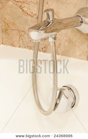 Faucet with handles and white bath