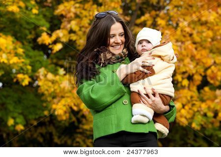 Young Mother With Baby In Arms Up