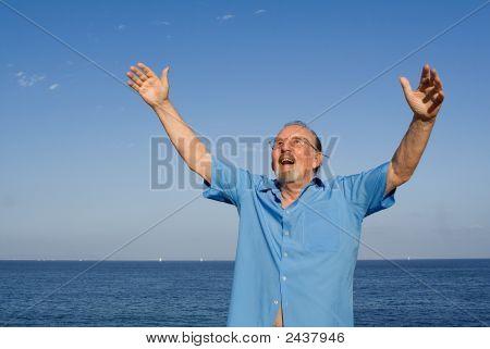 Senior Man Arms Raised With Joy