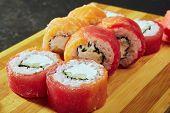 Philadelphia Sushi Roll - Maki Sushi with Philadelphia Cheese inside. Salmon and Tuna outside poster