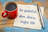 Be grateful, slow down, enjoy life - inspirational handwriting on a napkin with a cup of coffee poster