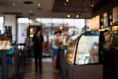 Defocused Coffee Cafe Interior Room Mall. Closed Space Show Window And Cash Desk With Buyers Custome poster