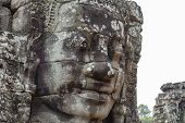 Stone Face Relief Of Ancient Buddhist Temple Bayon In Angkor Wat Complex, Cambodia. Ancient Architec poster