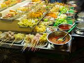 Asian Street Food. People Cooking, Selling And Buying Exotic Asian Food (thai, Malaysian, Chinese, K poster