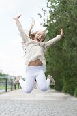 Girl On Happy Smiling Face, Nature On Background. Happiness Concept. Kid Girl With Cheerful Expressi poster