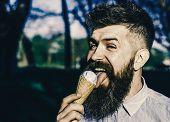 Funny Tourist. Man With Long Beard Licks Ice Cream, Close Up. Bearded Man With Ice Cream Cone. Man W poster