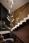 Stylish Modern Interior With Wooden Walls And A Stair With Wooden Rungs And A Glass Railing. There A poster
