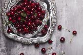 Fresh Cherries In Bowl On Table. Fresh Cherries In Pot On The Table.cherries. Sweet Cherries. Fresh  poster