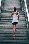 Young Woman Runner Sportswoman Climbing Up City Stairs Jogging And Running In Urban Training Workout poster