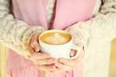 Girl Holding A Cup Of Coffee Or Hot Chocolate Or Chai Tea Latte. Quiet Hygge Time Concept. Warm Tone poster