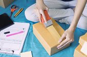 Woman Holding Pack Machine, Sealing Cardboard Boxes, Check Packing List Order And Delivery To Custom poster