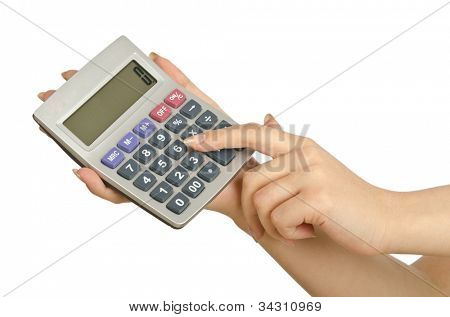 Hand holding calculator on white