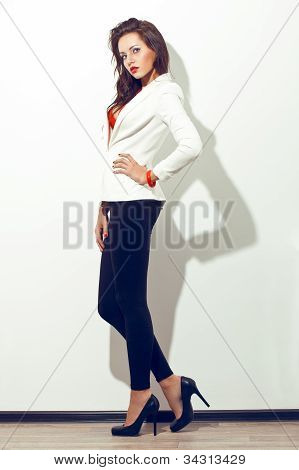sexy model posing over white wall