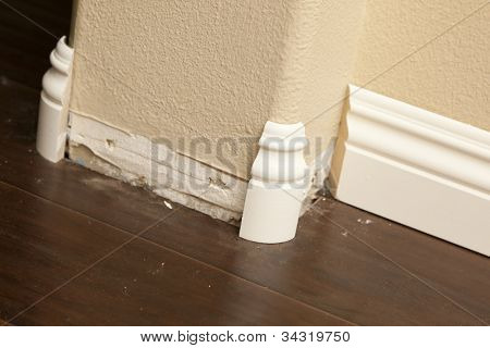New Baseboard and Bull Nose Corners with Laminate Flooring Abstract.