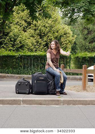 woman making hitchhiking
