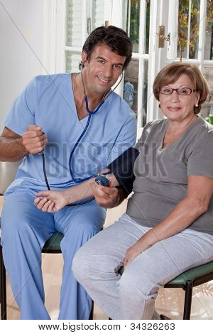 Doctor taking the blood pressure of a patient.
