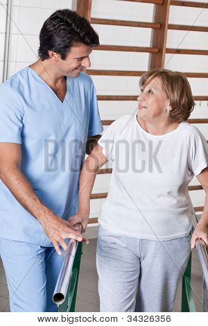 Mature man having ambulatory therapy with his therapist.
