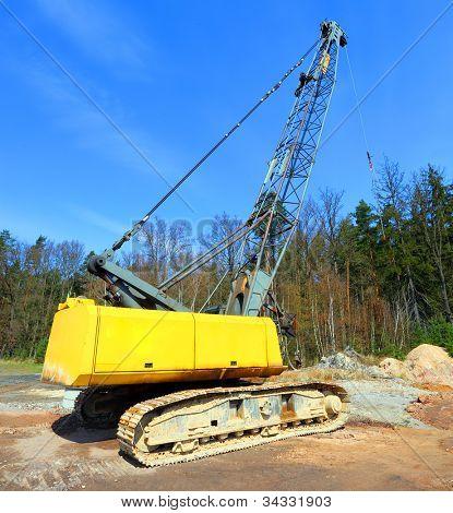 The loader excavator in a damaged landscape - road construction.