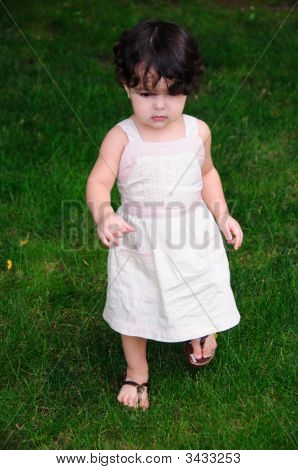Little Girl With Dress On Grass