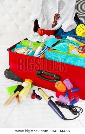 Travel Suitcase Packed For Woman Vacation With Personal Belongings. Concept. Preparation For Holiday