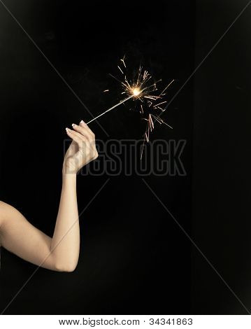 Hand holding sparkler