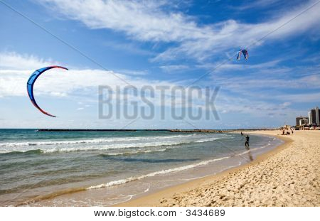 Two Kitesurfers On The Beach At Tel-Aviv