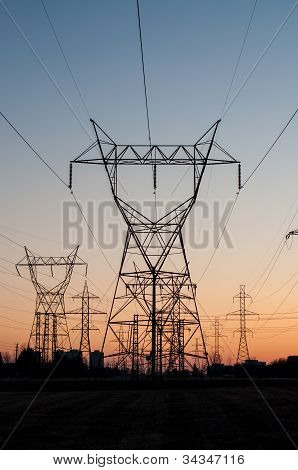 Electrical Transmission Towers (electricity Pylons) At Sunset