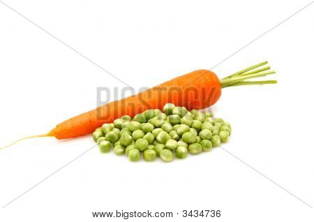 Carrot And Green Peas Isolated On A Whiteground.