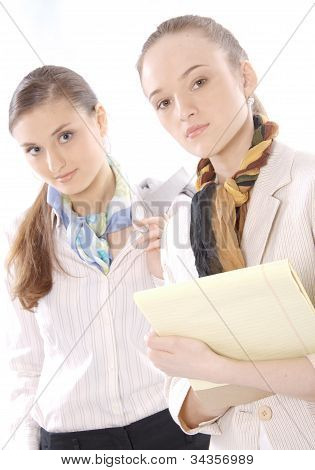 Closeup portrait of two beautiful young female business executives