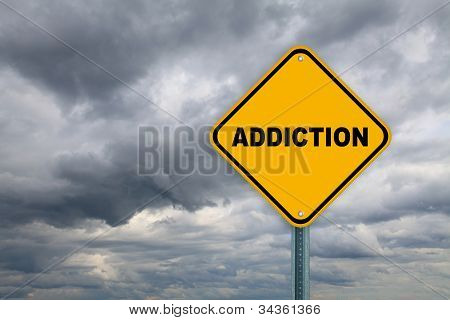 Yellow addiction road sign
