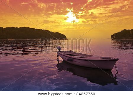 Sunset Scene With A Small Boat