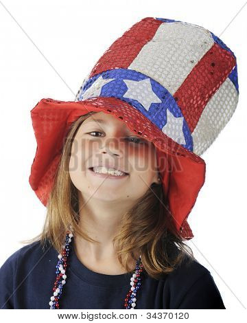 Close-up of a pretty elementary girl looking up from under a sparkly, over-sized Uncle Sam hat.  On a white background.