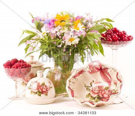 Vintage tea in elegant tableware, raspberry, cherry and flowers