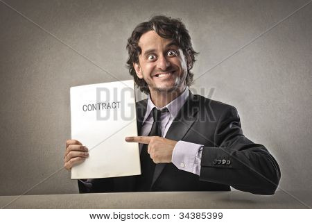Satisfied businessman showing a contract