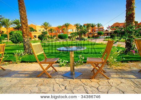 Resort And Small Lawn With Chairs  Early Morning.