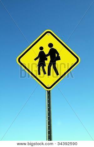 Yellow school crossing road sign