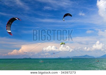 Wakeboarders Jumping From Water In Open Sea