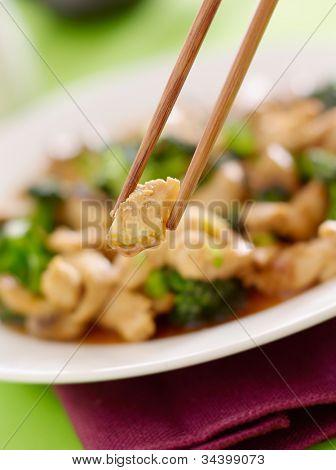 stir fry chopstick closeup eating chicken and broccoli