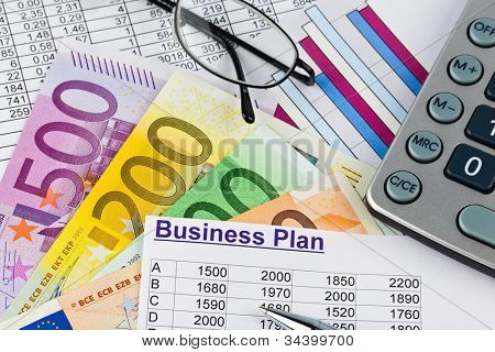 a business plan for starting a business. ideas and strategies for self-employment. euro bank notes and calculator