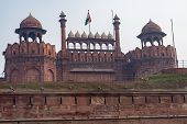 Striking View Of The Outside Of Red Fort In Delhi India, With The India Flag Waving poster